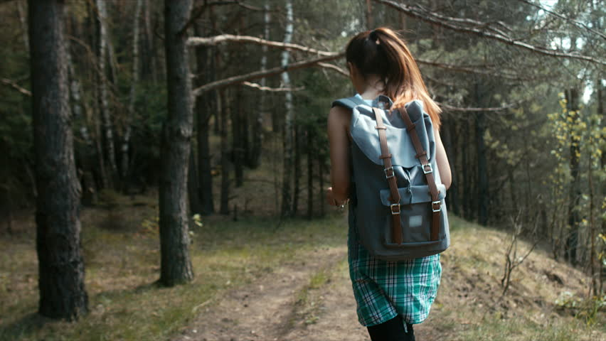 Active healthy hipster teen hiking in forest. 60 FPS slow motion. Blackmagic URSA Mini
