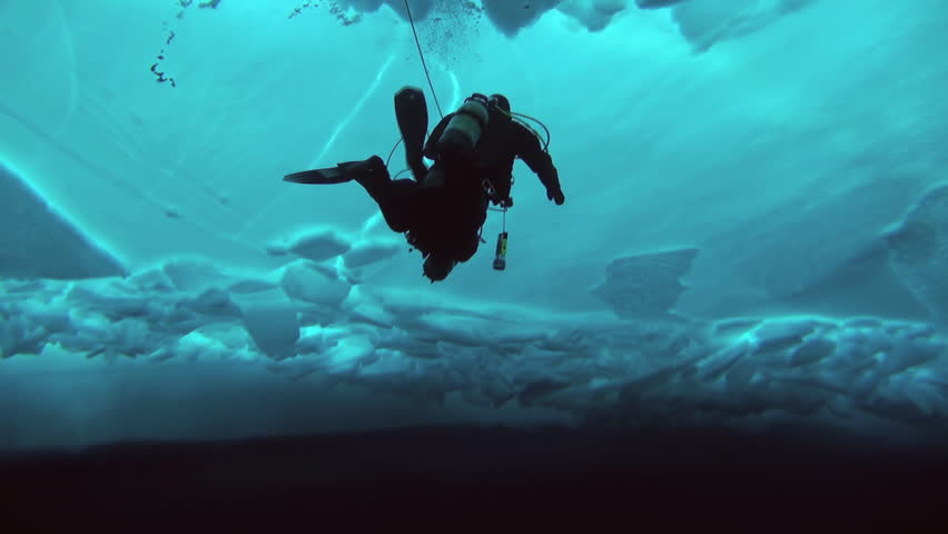 Unique extreme underwater shooting scuba dive beneath ice at geographic  North Pole in cold waters. Fantastic views of the lump of ice in water. ICE CAMP BARNEO, NORTH POLE, ARCTIC - APRIL 2015 | Shutterstock HD Video #16524385