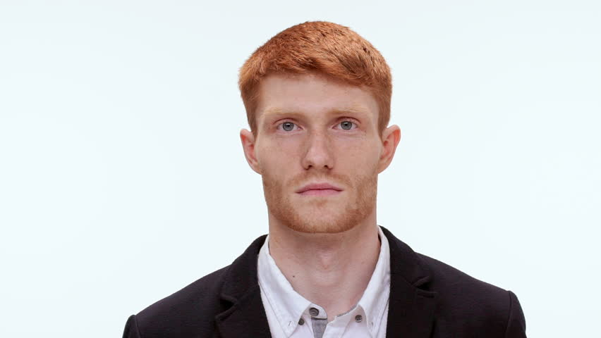 Handsome redhead man showing different emotions on white background. Close up. Slow motion