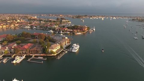 Aerial view in motion over the Newport Beach Harbor at sunset.  Linda Island is shown first followed by Harbor Island