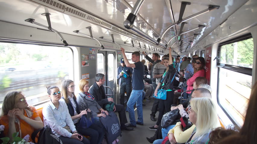 Kyiv/ukraine - May 13 2016: Underground Carriage Coming Down the Street, Sunny Day, People Are Sitting and Standing in the Car and Go, Passing Under the Bridge, Kiev, Ukraine | Shutterstock HD Video #16604635