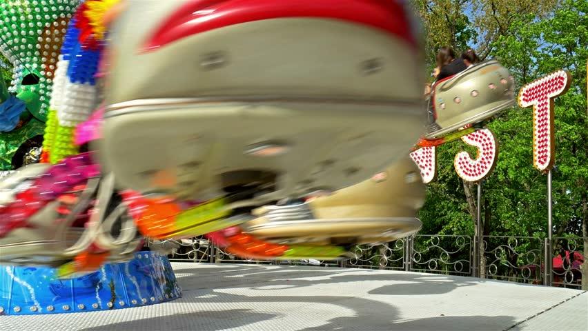 BUCHAREST, ROMANIA - MAY 15, 2016: Children And Parents Having Fun In Youths Public Amusement Park Ride (Tineretului Park).