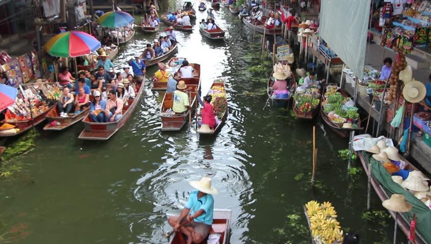 Damnoen Saduak Floating Market Thailand - January 12 2015: Tourist is travelling and enjoy on the Boat at Damnoen saduak floating market Thailand