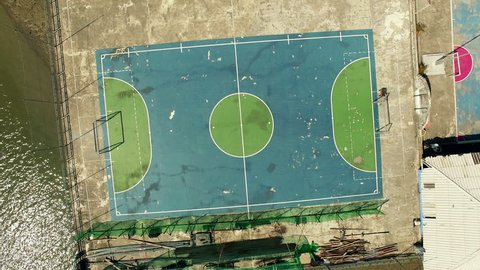 Vertical aerial video of a soccer field in the Floating village Panyee island, Phanga, Thailand, aerial shot with drone. N Video about soccer, football, travel, nature.