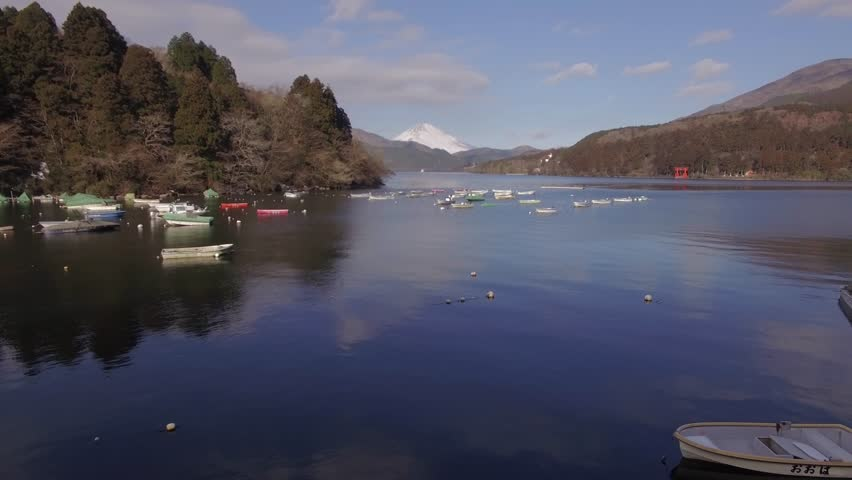 Aerial footage of Mount Fuji and rental boats at Lake Ashi on a Winter morning, Kanagawa Prefecture, Japan - 4K stock footage clip