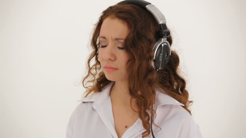Woman Listening To Music. A Girl In A White Shirt And Headphones ...