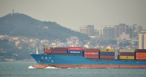 May 12,2016:4k Cargo Container Ships Through The QingDao Harbo,moder urban building,china. gh2_11324_4k