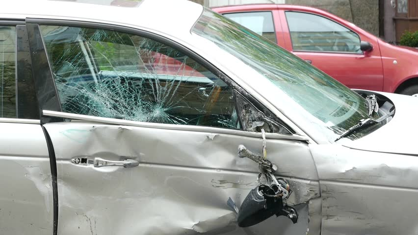 Broken car is on the road after the accident. Close-up