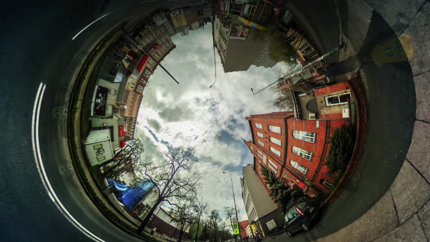 People Walk by City Street Among Buildings, Red Bricks Houses, vr Video 360, Little Planet Video, Video For Virtual Reality, Time Lapse, Road Markings, Cars Moving by Paved Road, White Clouds, | Shutterstock HD Video #16765480