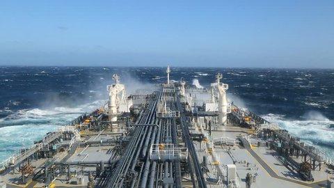 Tanker steaming through stormy ocean
