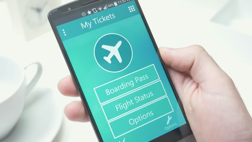 Viewing a plane boarding pass on smartphone screen.