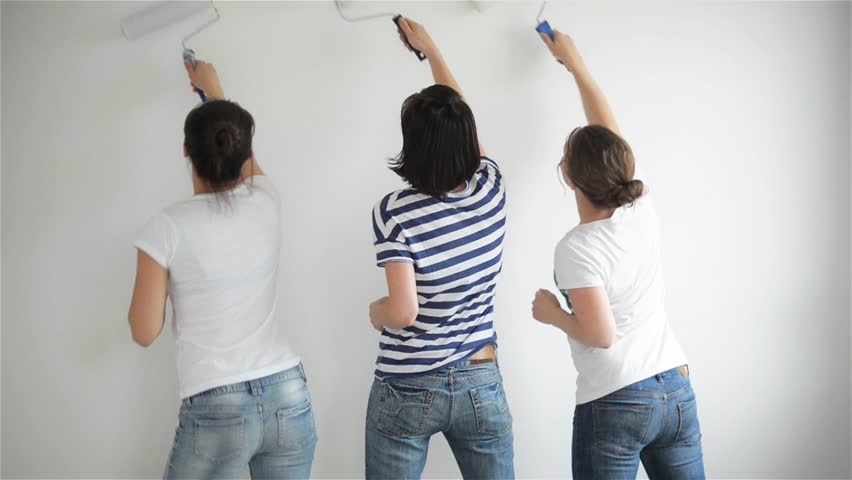 Friends makes repairs at home. Funny girls dance and paint the walls in the flat, good mood, making repairs and dance | Shutterstock HD Video #16844416