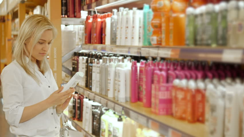 Beautiful Woman Choosing Body Care Products In Supermarket | Shutterstock HD Video #16897579