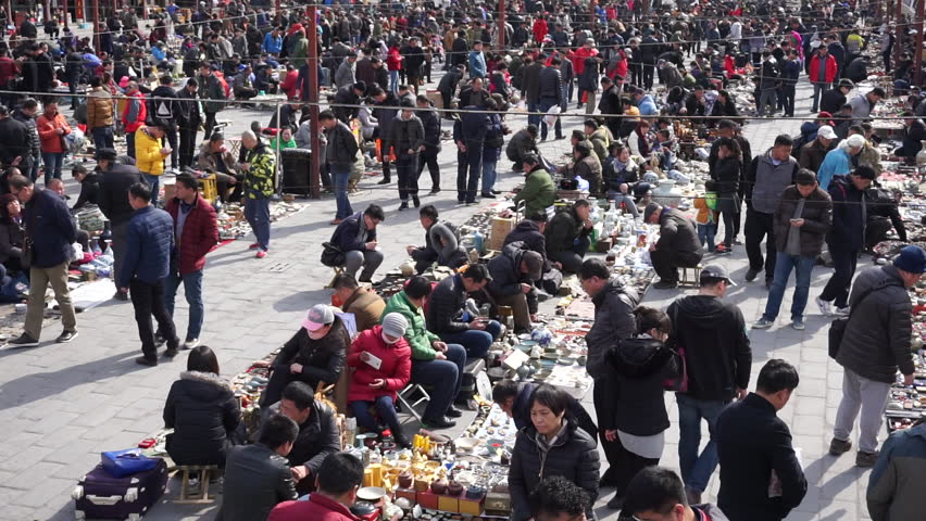 Feb.27,2016-Beijing,China: Beijing Panjiayuan market is the most popular antique market in China. On Saturday and Sunday, there are more vendors and visitors coming to the flea market. #16914445