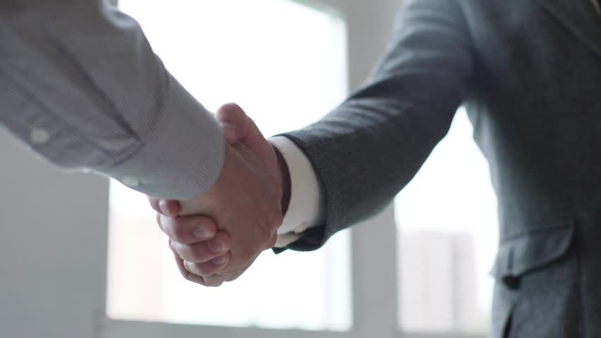 Business partners handshaking | Shutterstock Video #16923535