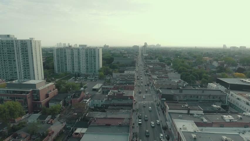 Aerial establishing shot of a large arterial road in a busy metropolitan city. 4K cinematic footage. | Shutterstock HD Video #16957855