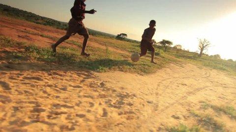 KENYA, AFRICA - CIRCA AUGUST 2010: Children playing soccer on the fields in Kenya, Africa circa August 2010.