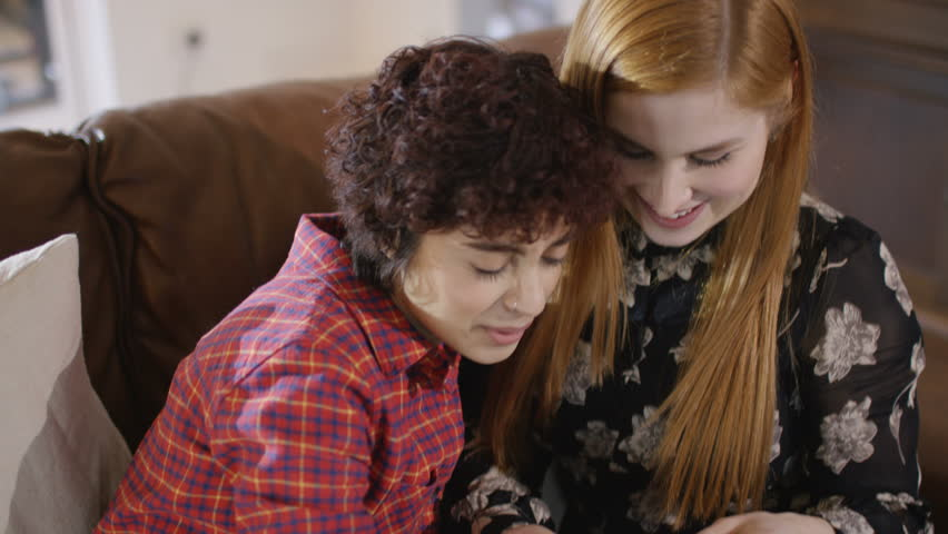 4K Happy gay female couple at home pose to take a selfie with mobile phone UK - April, 2016 | Shutterstock HD Video #17021131