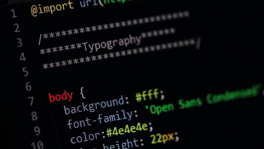 Scrolling through websites CSS sheet in a dark color-schemed editor window. Cascading style sheet scrolling stops from time to time so a lot of IT and webdesign relevant keywords can be read. | Shutterstock HD Video #17025925