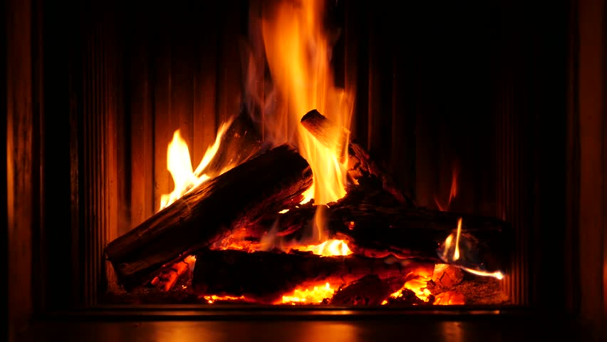 Fire in a fireplace of a chalet in Belgium