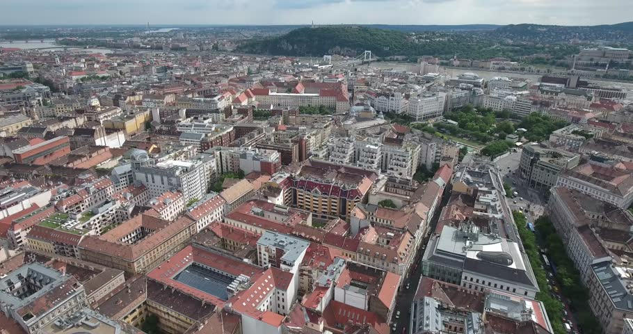 Aerial footage from a drone shows residential area and downtown Budapest. - 4K stock footage