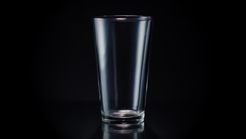 This shot of a liquid being poured was filmed as part of a set. This set includes beverages of all types in various types of glasses and at two different angles. Check out my channel for more! | Shutterstock HD Video #17101555