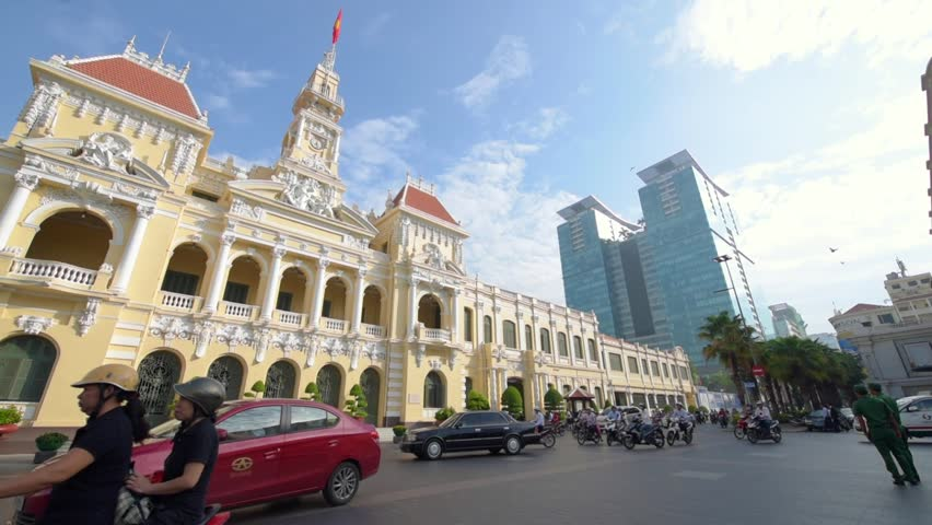 Ho Chi Minh City, Vietnam - May 21, 2016: Traffic in front of the City Hall in Ho Chi Minh City (Saigon), Vietnam.
