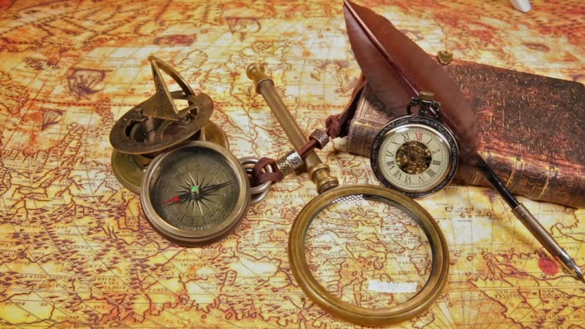Vintage magnifying glass compass telescope and a pocket watch vintage clocks on the map old world map in 1565 hd stock video gumiabroncs Image collections