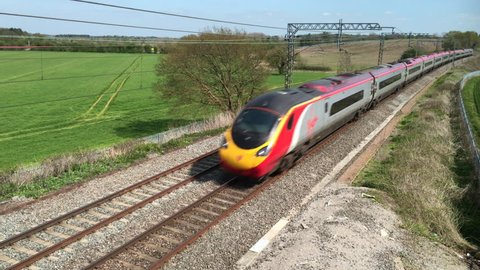 Northamptonshire, UK - May 06, 2016: A Virgin Trains Pendolino tilting electric express passenger train traveling north at speed on the West Coast mainline England.