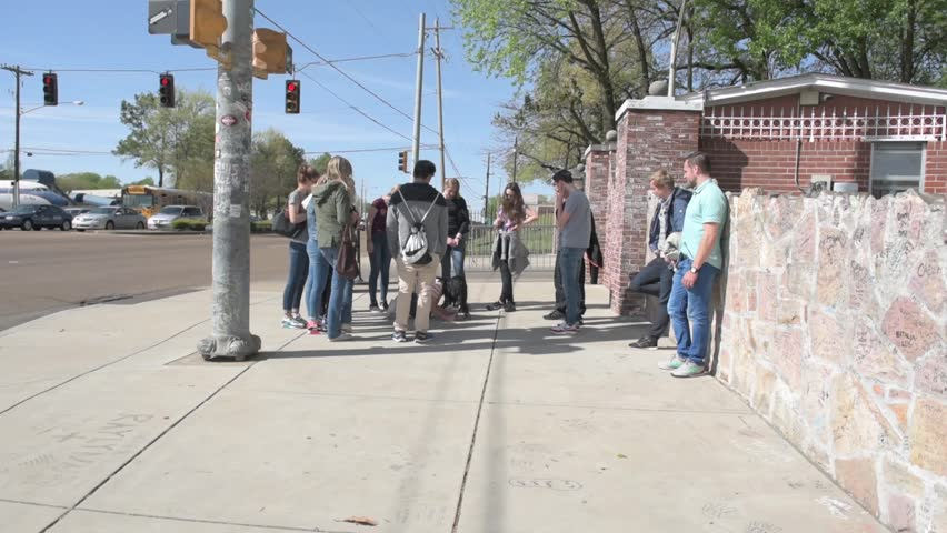 MEMPHIS, TENNESSEE - APRIL 09, 2016: Elvis Presley Mansion Wall in Graceland, Memphis. Group Of Tourist by the gate