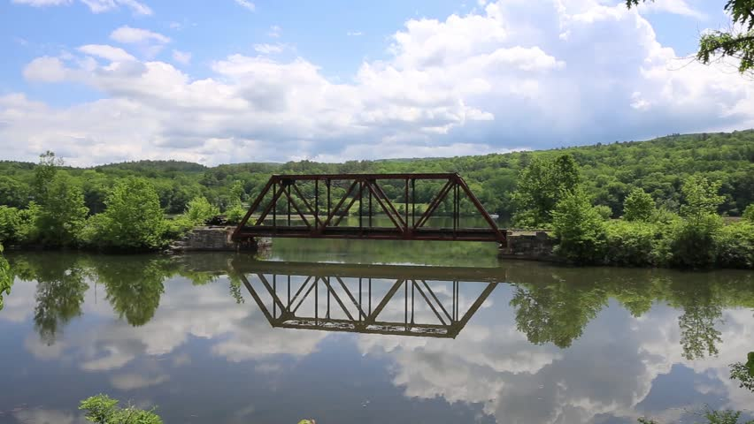 Amtrak Train Bridge Crossing A Body Of Water Along The Connecticut River In  Vermont.