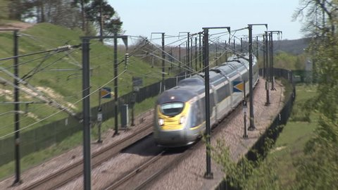 HOLLINGBOURNE, KENT, ENGLAND - MAY 6, 2016 - New new class 374 e320 Eurostar train heads along the High Speed One line in Kent with a Paris to London St Pancras service.