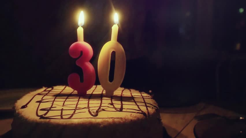 Man with birthday cake blows candles at his 30th birthday in man with birthday cake blows candles at his 30th birthday in slowmotion 1920x1080 hd sciox Image collections