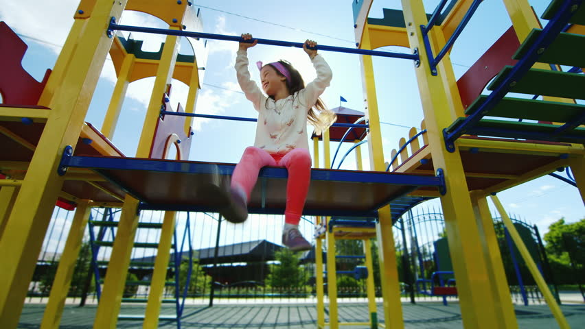 Girl Playing On The Playground Laughter Fun Sunshine In Her Hair He