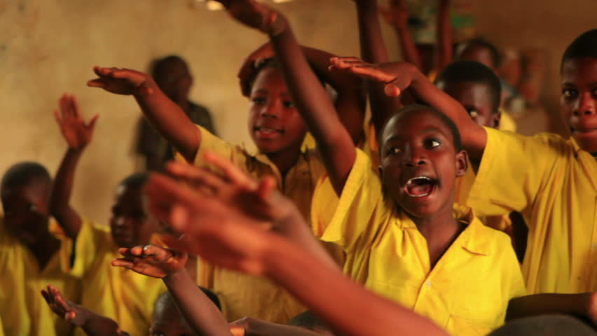 KENYA, AFRICA - CIRCA 2011: Close up of boys raising his hand in a full classroom in Kenya, Africa.