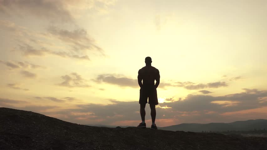 Beauty of human's body. African american bodybuilder posing at sunset during his outdoor training. Moment of full harmony and relaxing | Shutterstock HD Video #17251471