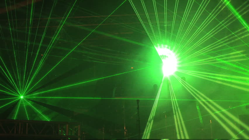 Colored laser light show in a club