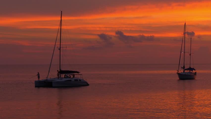 Orange sunset sky ocean boat ride bay panorama 4k phuket thailand   Shutterstock HD Video #17342245