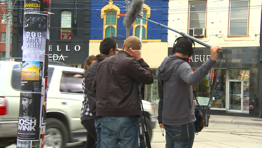 TORONTO, CANADA -OCTOBER 16, 2010: A small film crew at work on a street on October 16, 2010 in Toronto, Canada