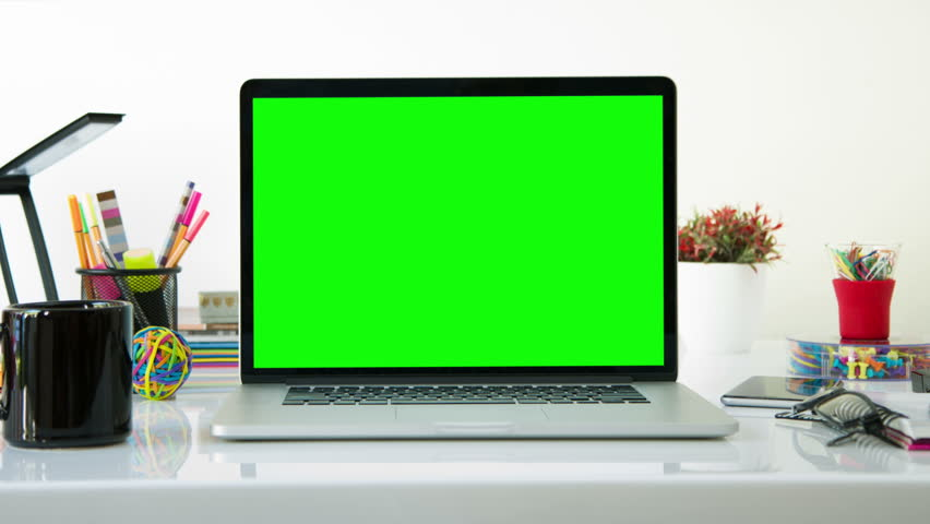 Laptop with colorful office elements. Dolly in. Chroma Key. Perfect to put your own images or videos. Track with perspective corner pin.