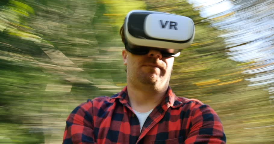 Conceptual shot man wearing virtual reality goggles in the 360 VR world