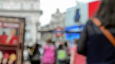 Unknown blurred walking people on streets of London
