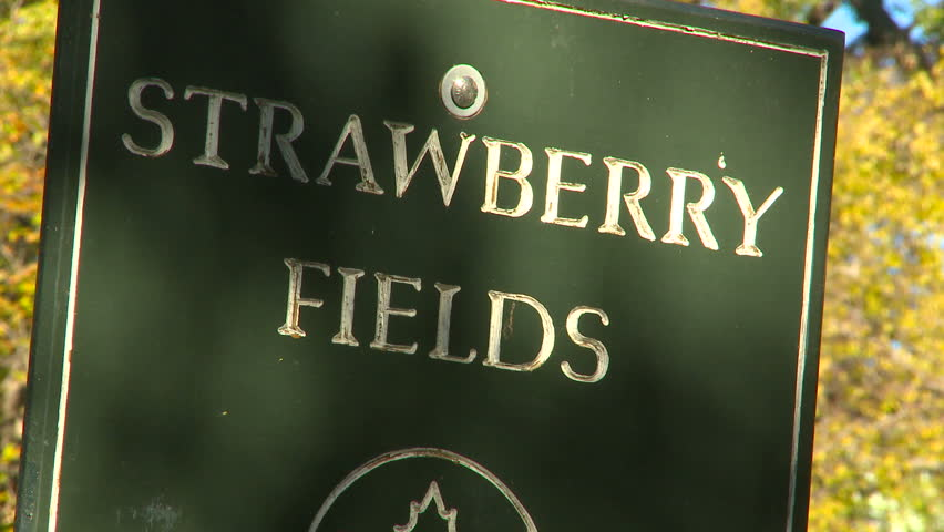 NEW YORK, NY - NOVEMBER 9, 2010: Zoom out from the Strawberry Fields sign in New York's Central Park | Shutterstock HD Video #1744735