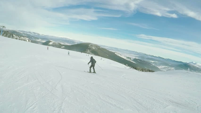 Riding on skis man down road | Shutterstock HD Video #17454955