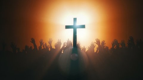 Silhouettes of hands raised in worship with Cross and Dove .