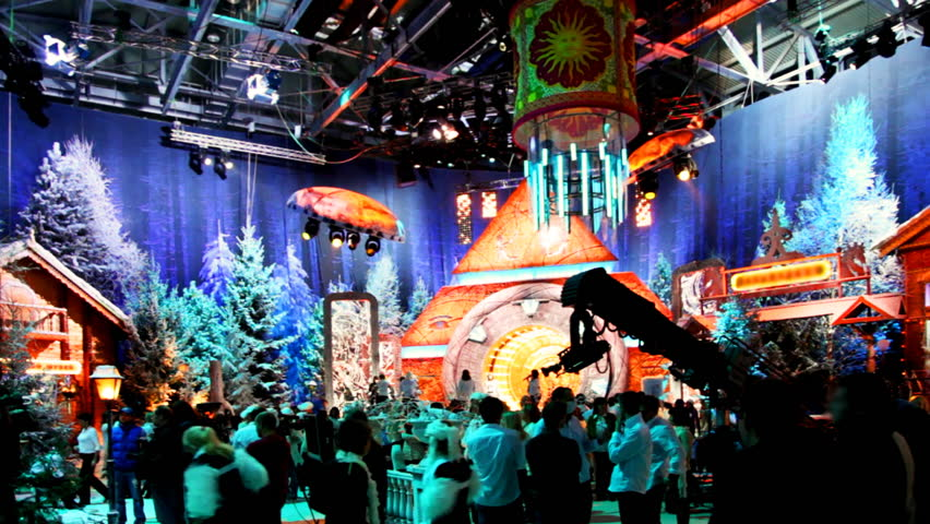 people in pavilion at television studio is preparing to shoot Christmas TV shows