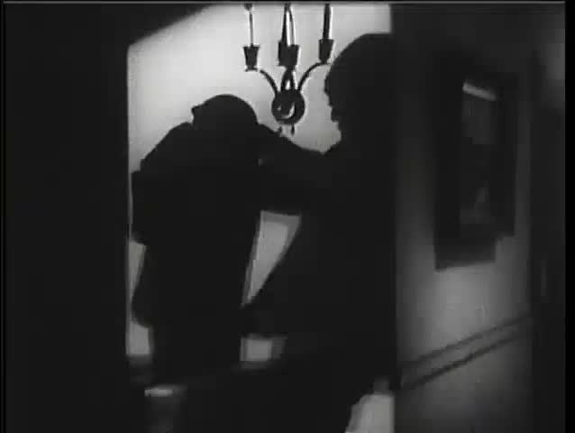 Silhouette of man strangling another man in dark hallway, 1940s