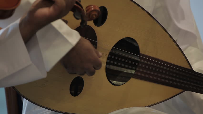 Musical Instruments. CU on the hand of a musician playing the oud or lute, a type of Middle Eastern guitar. (Bahrain - 2012)