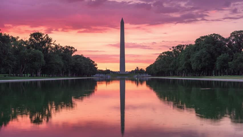 Washington Monument on the Reflecting Pool in Washington DC, USA.