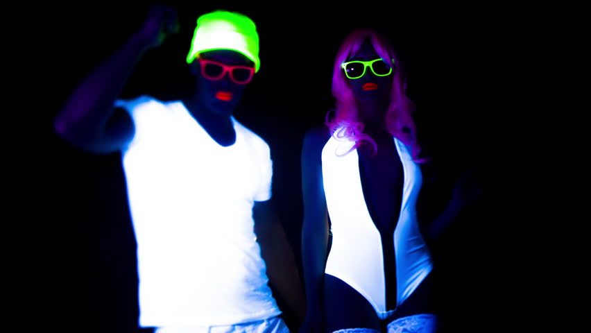 Fantastic video of sexy cyber raver man and woman filmed in fluorescent clothing under UV black light | Shutterstock HD Video #17575135